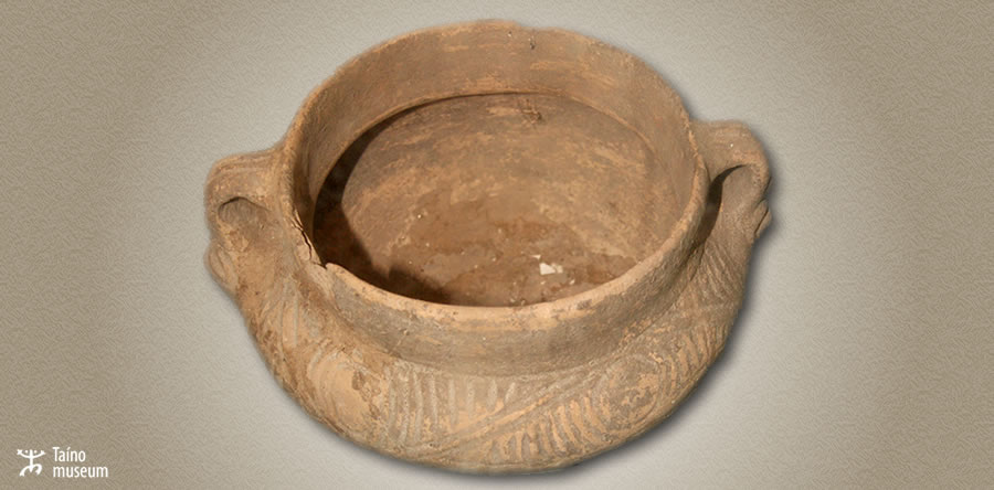 Chican pot with incised decoration and anthropomorphic bilateral handles